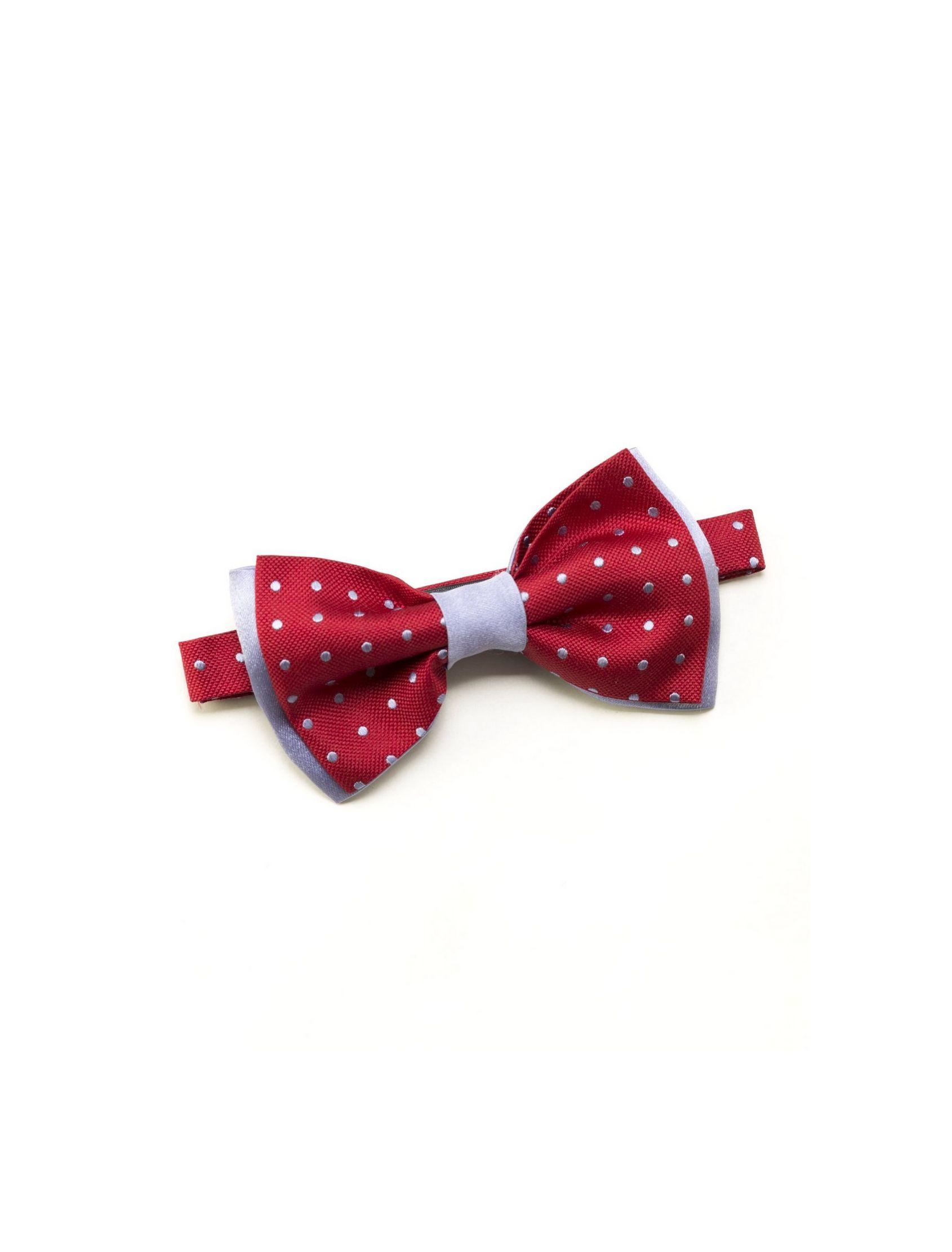 Original y divertida pajarita en rojo con estampado polka dots en blanco. De seda natural