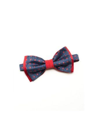 Original y divertida pajarita en azul con estampado polka dots en rojo. De seda natural