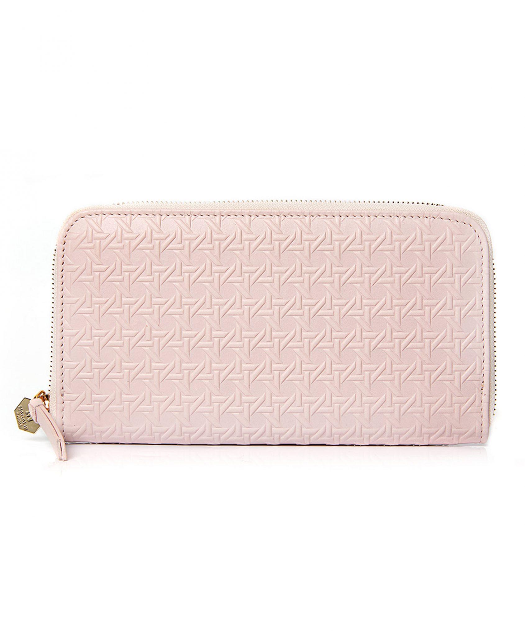 cartera billetera discrete de piel en tonos rosa pastel.