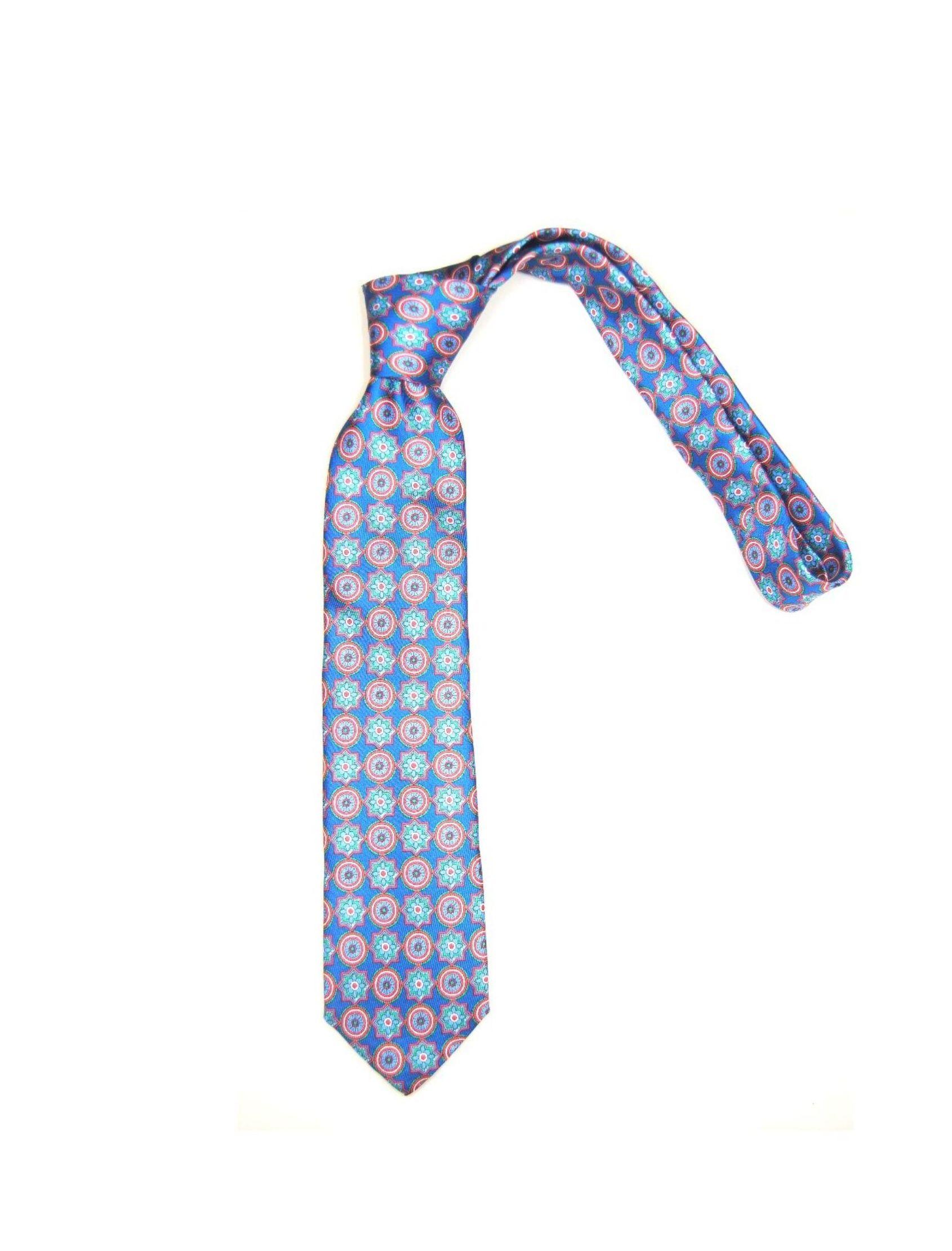 Corbata hombre con estampado geométrico en azul y rojo. Fabricada en seda100%