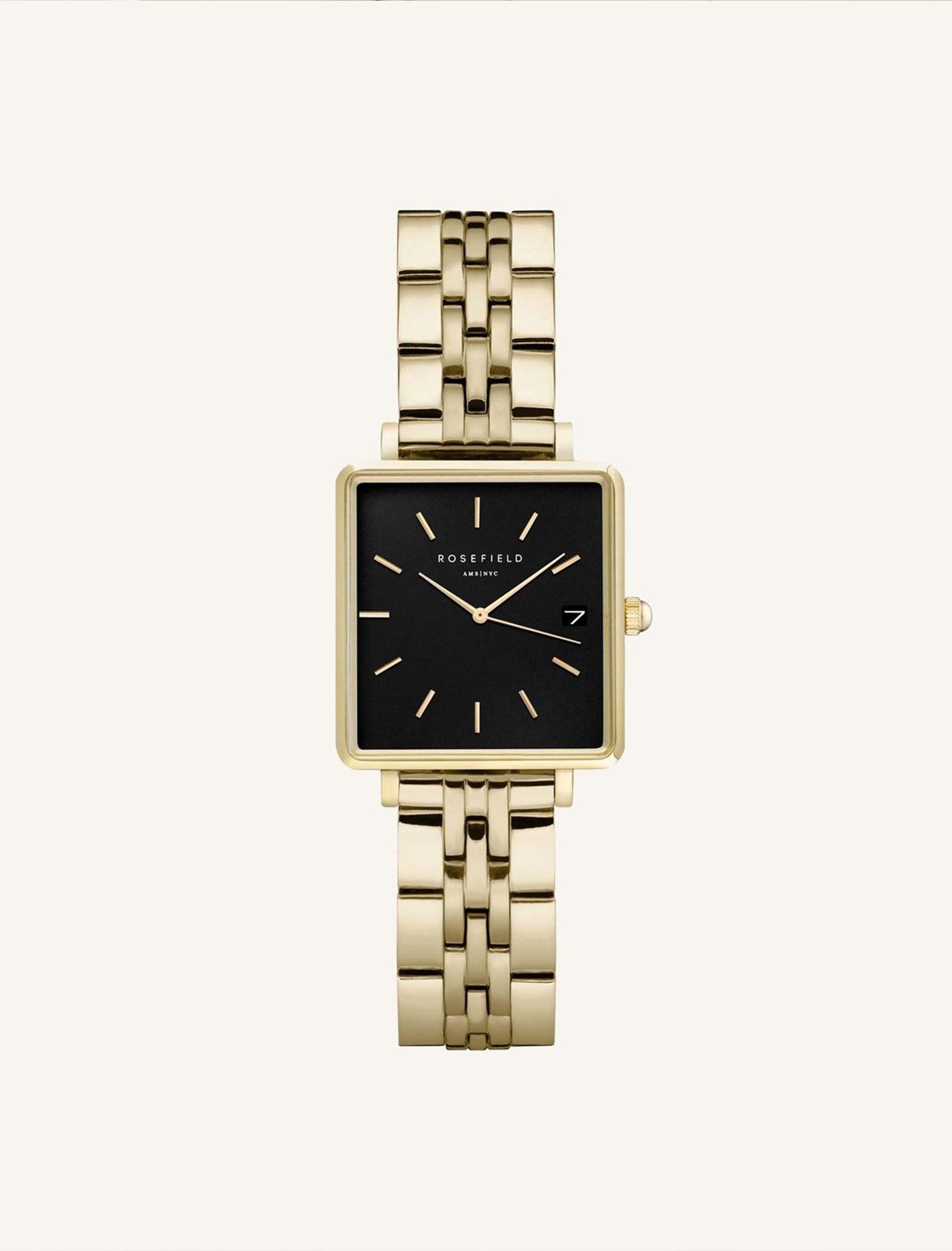 reloj the boxy Rosefield con esfera negra y correa dorada