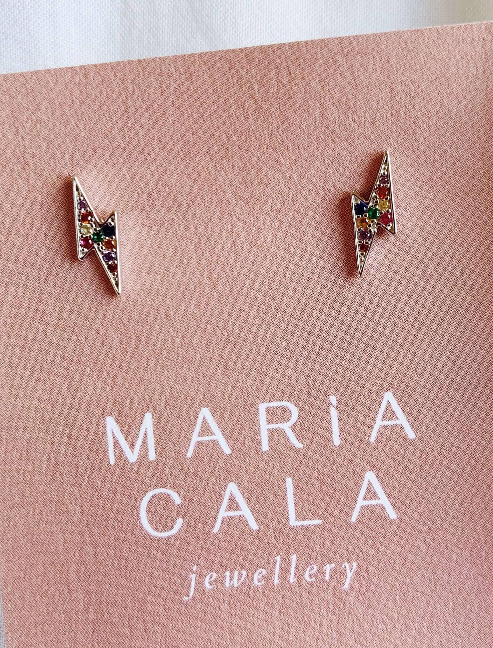 Pendiente de plata en forma de trueno con circonitas con toques de color. Perfecta combinación de la mano de Maria Cala.