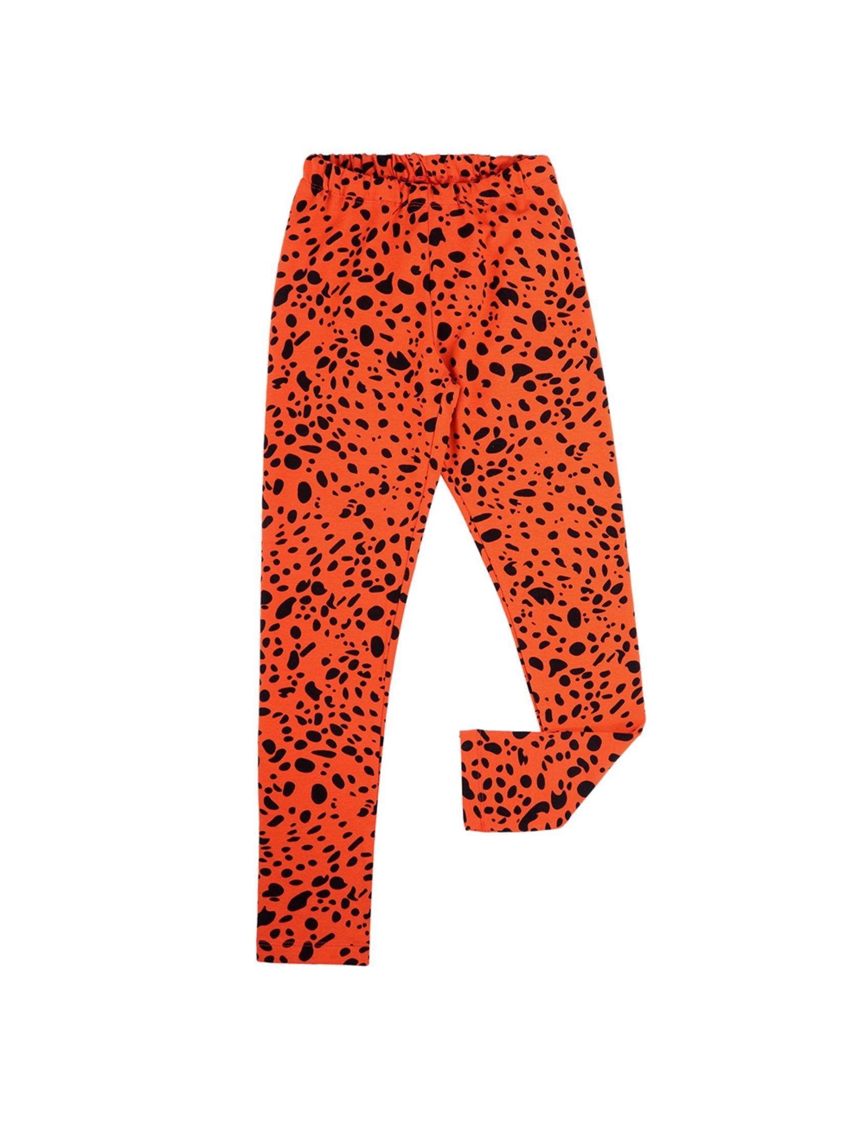 legging unisex para niño y niña con base roja y estampado animal print en negro de carlijnq