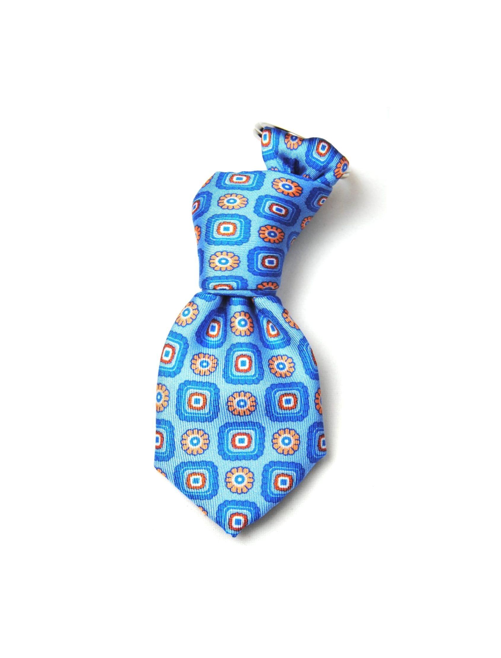 llavero mini corbata con estampado en tonos naranja inspirado en el amanacer de filipinas