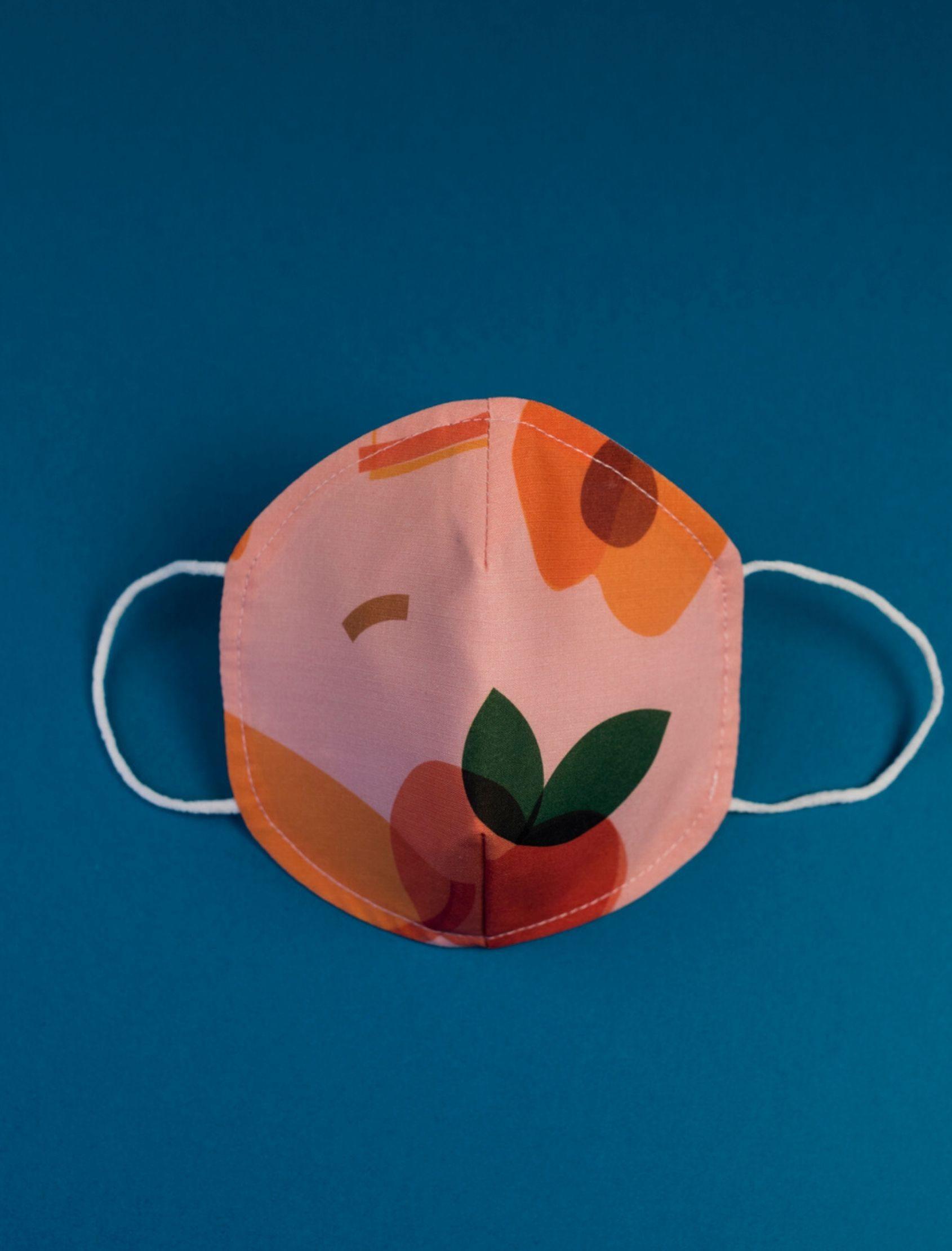 mascarilla infantil con estampado peach multicolor y tejido homologado